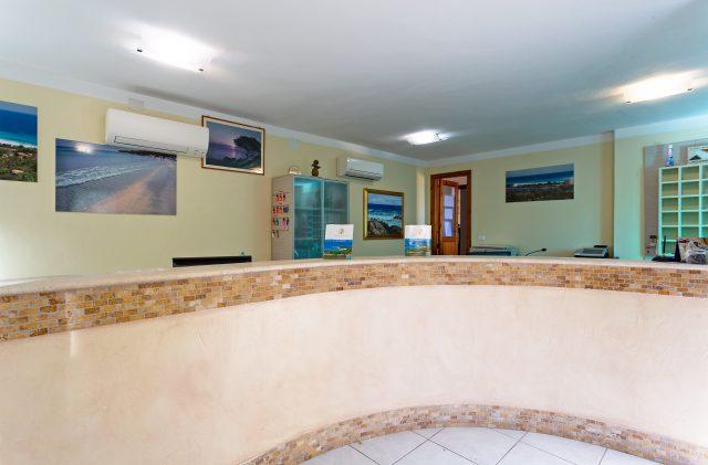 The reception desk at Camping Cala Ginepro