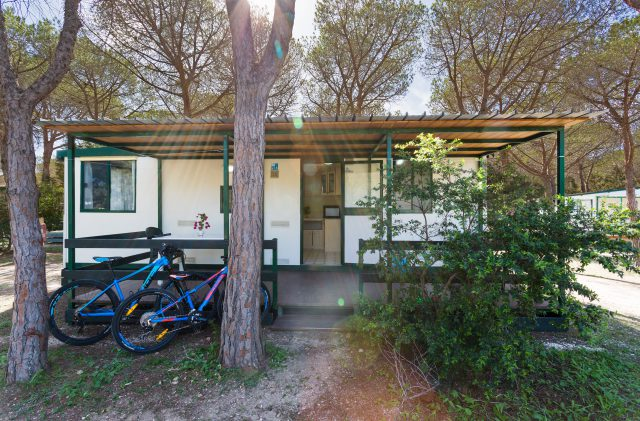 The exterior of an Economy Bungalow at Camping Cala Ginepro