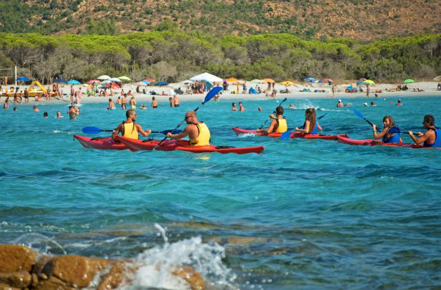 Three kayaks in Sardinia, in the turquoise sea of Cala Ginepro